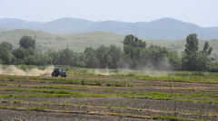 tractor, hd1080i: farmer cultivating a field in the beautiful countryside. - stock footage
