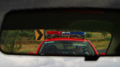 Police emergency lights in the rearview mirror Stock Footage