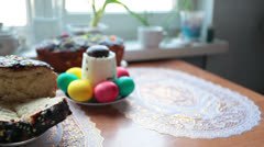 Easter set on domestic kitchen with cake and eggs Stock Footage