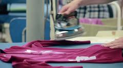 Female worker working with professional ironing appliance at textile factory. Stock Footage