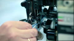 Close up woman hands sewing fabric on sewing machine at textile factory Stock Footage