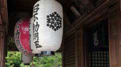 Red and white paper lanterns in Fudo-do, Kinkaku-ji, Japan Stock Footage