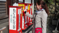 English fortune papers for money in Japan shrine Stock Footage