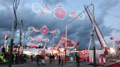 Amusement park  at dusk Stock Footage