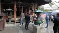 Incense burner in Fudo-do temple, Kinkakuji shrine, Kyoto, Japan Stock Footage