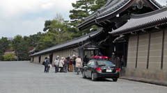 Siesho-mon gate with tourists entering to Imperial Palace in Kyoto, Japan Stock Footage