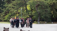 Tourists with tour guide in a head going in line, Kyoto, Japan Stock Footage