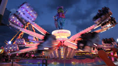 Carousel in amusement park at night - stock footage