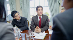 Attractive and diverse business team in a meeting around a conference table Stock Footage