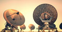 Broadcasting, receiving space telescopes satellite dishes. Extraterrestrial UFO Stock Illustration