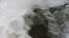 Water surges over rock Stock Footage