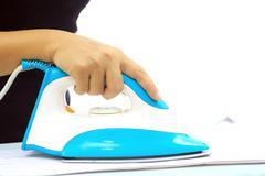 Clothes ironing Stock Photos