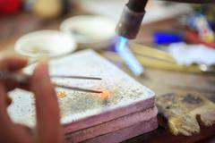 Stock Photo of goldsmith making gold