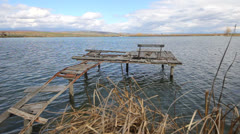 Desolated pontoon with a single bench Stock Footage