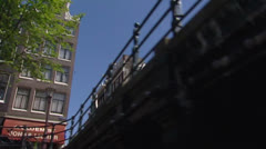 AMSTERDAM Canal district cruise along facades and gabled dwellings  Stock Footage