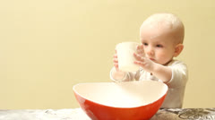Stock Video Footage of Funny baby pouring with a cup flour in a bowl