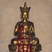 golden statue of vikirna in buddhist temple, beijing - stock photo