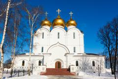 white steeple church with domes and walls - stock photo