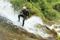 Canyoning Guide Trying Out A New Route In Chama Waterfall Banos De Agua Santa Stock Photos