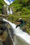 Canyoning Guide Trying Out A New Route In Chama Waterfall Banos De Agua Santa - stock photo