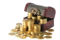 A wooden ancient chest full of money . Stock Photos
