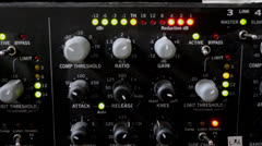adjusting gain on sound compressor - stock footage