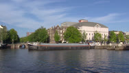 Stock Video Footage of AMSTERDAM -  River Amstel with barge boat sailing in front of city theater