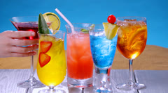 Taking colorful summer drinks Stock Footage