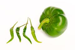 Green chili and bell peppers isolated on white background Stock Photos