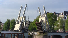 AMSTERDAM - draw bridge crossing river Amstel closes Stock Footage