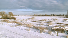 View of flooded river ijssel from dike in winter, The Netherlands Stock Footage