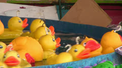 Hook a duck fairground game - stock footage
