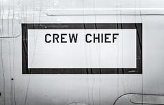 sign of crew chief on side of military airplane. - stock photo