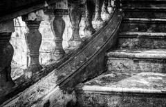 massive old staircase with beautiful details. - stock photo