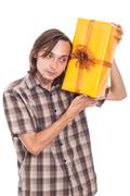Stock Photo of curious man with present