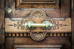 Detail of door with metal handle and keyhole. Stock Photos
