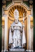 catholic priest statue of nice cathedral. - stock photo