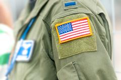 focus on american flag on usaf uniform of person. - stock photo