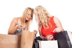 Happy girls shopping Stock Photos