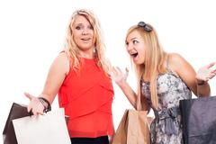 Excited girls shopping and arguing Stock Photos