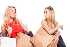 Jealous girls shopping and arguing Stock Photos