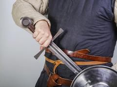 Unsheating a medieval sword Stock Photos