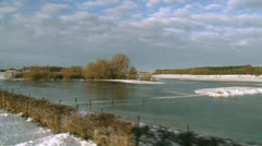 Flooded and frozen river ijssel from dike in winter - vehicle shot Stock Footage