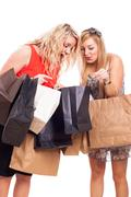 ecstatic girls with shopping bags - stock photo