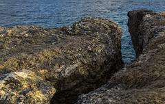 Chunk of cliff breaks away Stock Photos
