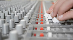Mixing levels on sound board reup Stock Footage