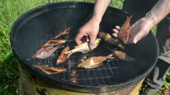 Man hand take fresh smoked fish from smokehouse Stock Footage
