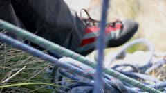 Climbing rope being taken in at belay Stock Footage