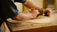 Luthier working in a guitar Stock Footage