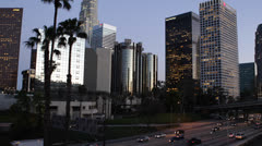 Los Angeles, LA Commute, Dusk Downtown , California, Rush Hour on Freeway, USA Stock Footage